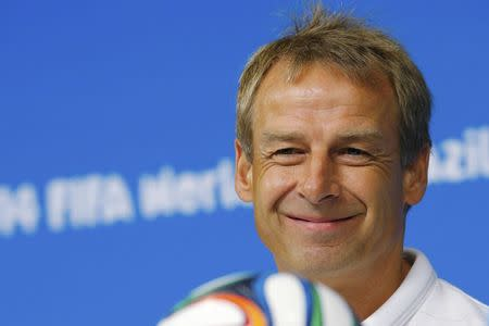 United States national soccer team head coach Juergen Klinsmann smiles while answering a question during a news conference at the Pernambuco arena in Recife