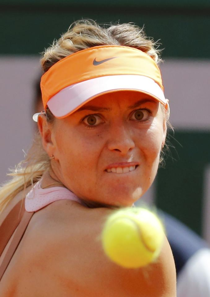 Maria Sharapova of Russia eyes the ball during her women's semi-final match against Eugenie Bouchard of Canada at the French Open tennis tournament at the Roland Garros stadium in Paris June 5, 2014. REUTERS/Jean-Paul Pelissier (FRANCE - Tags: SPORT TENNIS)