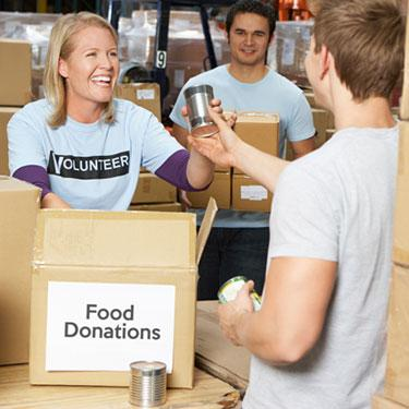 Volunteers-collecting-food-donations-at-warehouse_web