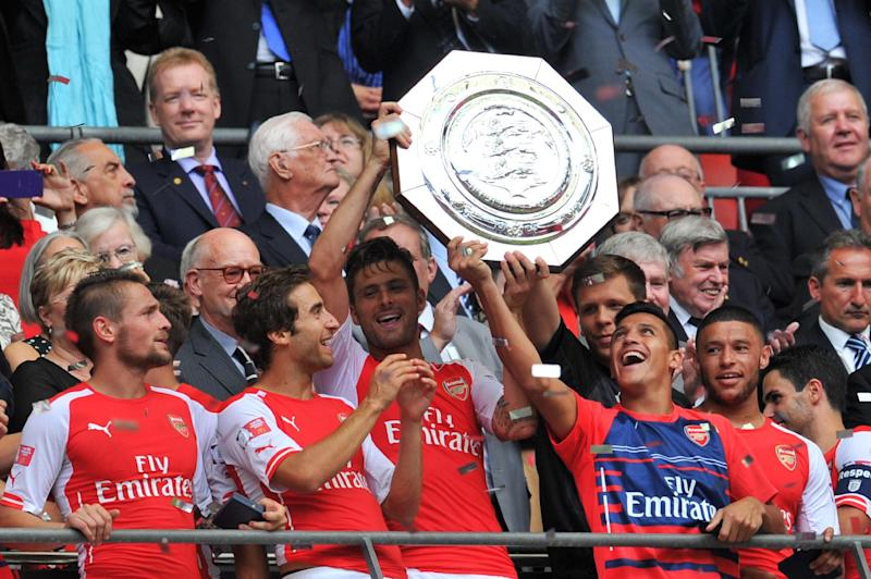 Arsenal players lift the Community Shield trophy after winning against Manchester City at Wembley, August 10, 2014