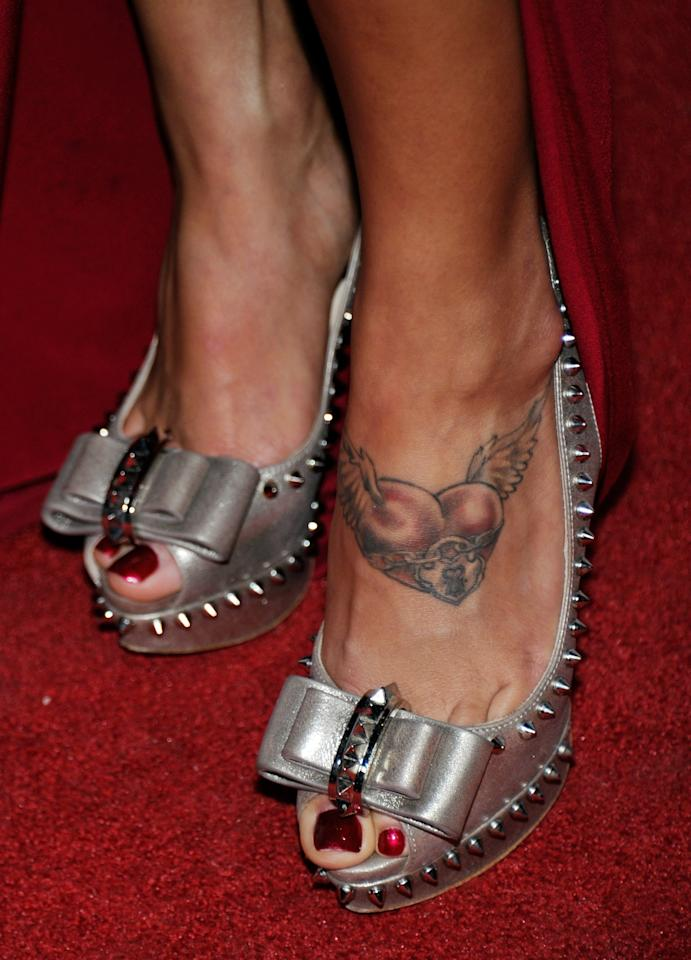 LAS VEGAS, NV - NOVEMBER 30:  Ring girl and model Arianny Celeste (shoe, tattoo details) poses after winning the Ring Girl of the Year award at the Fighters Only World Mixed Martial Arts Awards 2011 at The Pearl concert theater at the Palms Casino Resort November 30, 2011 in Las Vegas, Nevada.  (Photo by Ethan Miller/Getty Images)
