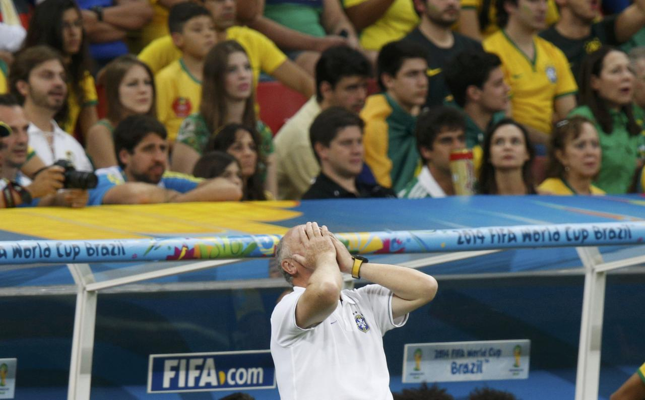 Brazil's coach Luiz Felipe Scolari reacts as his team plays against the Netherlands during their 2014 World Cup third-place playoff at the Brasilia national stadium in Brasilia July 12, 2014. REUTERS/Ueslei Marcelino (BRAZIL - Tags: SPORT SOCCER WORLD CUP TPX IMAGES OF THE DAY)