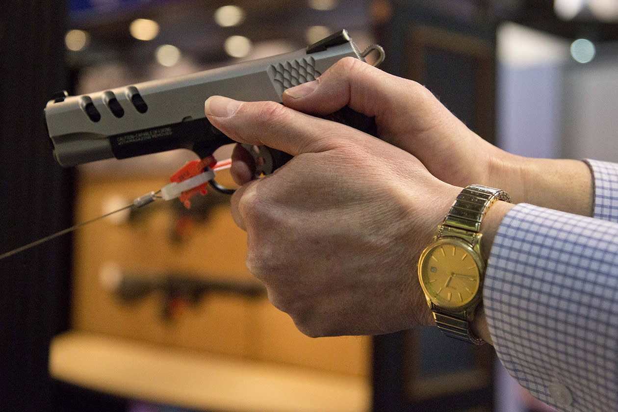The Smith & Wesson .45 caliber M1911pistol is held at the 35th annual SHOT Show.