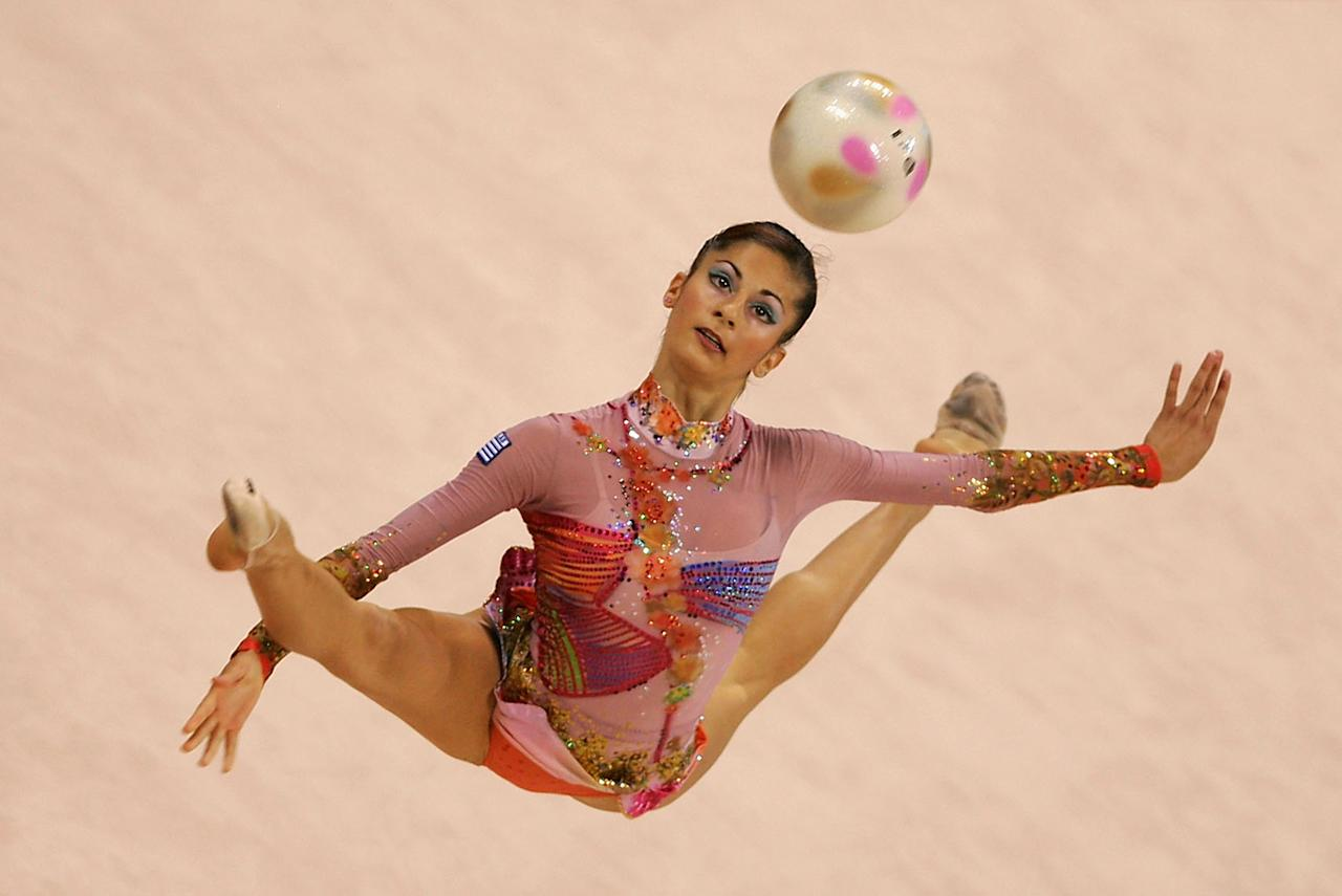 ATHENS - AUGUST 26: Eleni Andriola of Greece performs in the rhythmic gymnastics individual qualifications on August 26, 2004 during the Athens 2004 Summer Olympic Games at the Galatsi Olympic Hall in Athens, Greece. (Photo by Mike Hewitt/Getty Images)