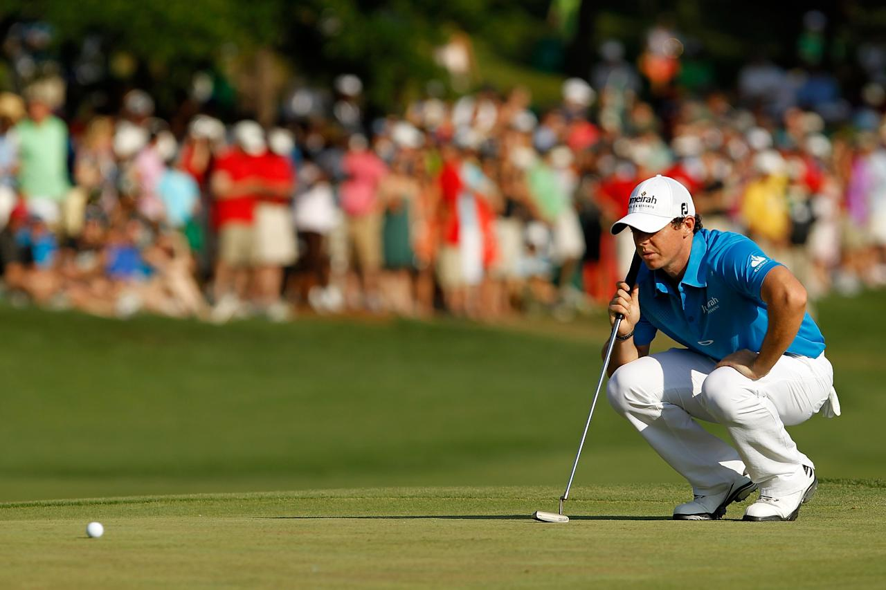 CHARLOTTE, NC - MAY 06: Rory McIlroy of Northern Ireland lines up his putt on the 18th green during the final round of the Wells Fargo Championship at the Quail Hollow Club on May 6, 2012 in Charlotte, North Carolina.  (Photo by Streeter Lecka/Getty Images)