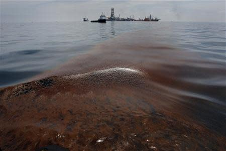 File of dispersed oil floats on the surface of the Gulf of Mexico waters close to the site of the BP oil spill off Louisiana