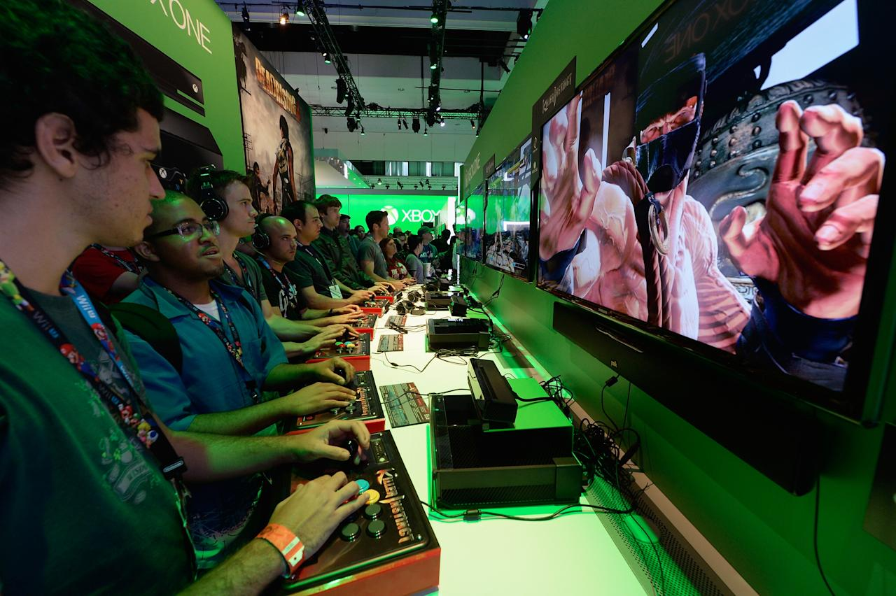 LOS ANGELES, CA - JUNE 11:  Gamers play a game on the Xbox One console in the Microsoft Exbox Xbox booth during the Electronics Expo 2013  at the Los Angeles Convention Center on June 11, 2013 in Los Angeles, California. Thousands are expected to attend the annual three-day convention to see the latest games and announcements from the gaming industry.  (Photo by Kevork Djansezian/Getty Images)