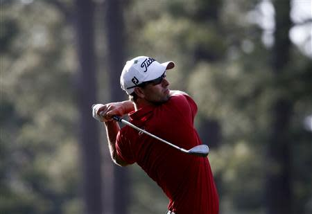 Australia's Adam Scott hits a shot on the 14th hole during the second round of the Masters golf tournament at the Augusta National Golf Club in Augusta
