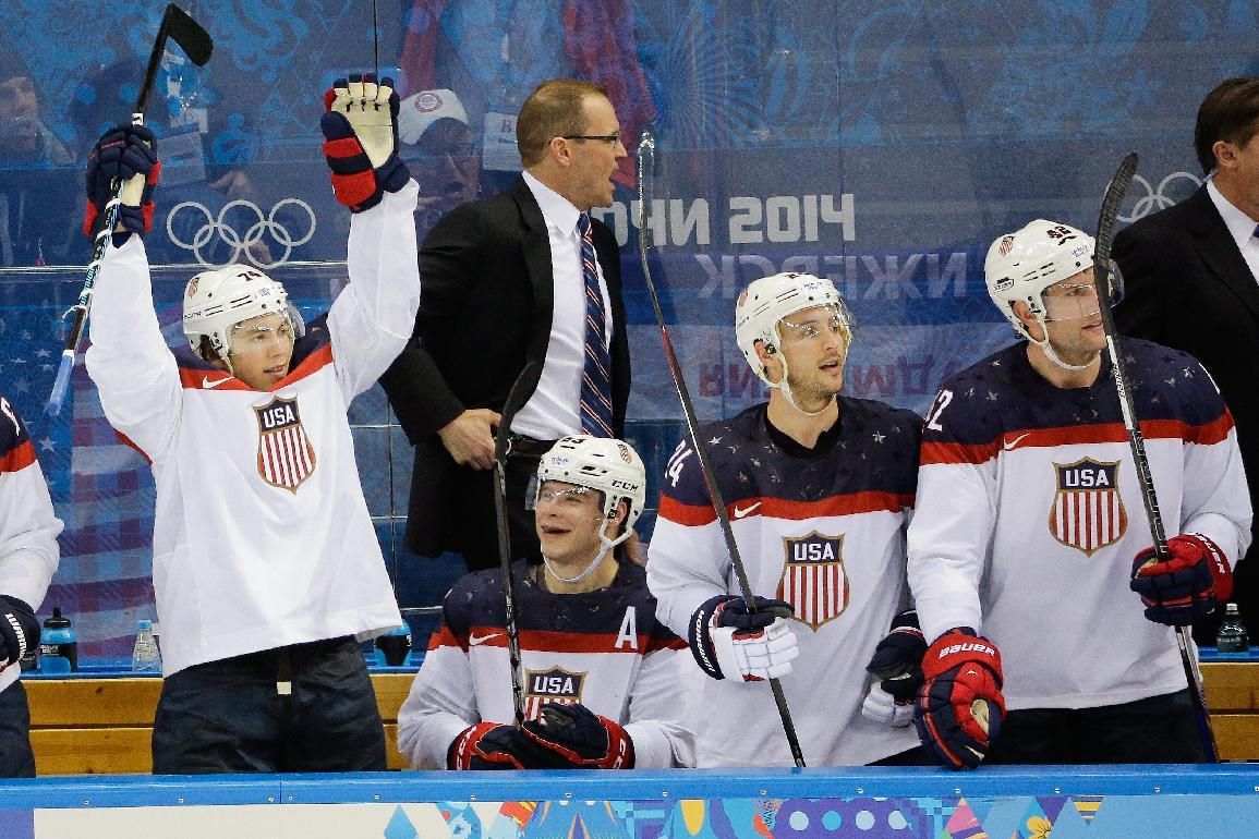 Team USA player reacts from the bench after a goal by forward Phil Kessel during the third period of men's quarterfinal hockey game against the Czech Republic in Shayba Arena at the 2014 Winter Olympics, Wednesday, Feb. 19, 2014, in Sochi, Russia. (AP Photo/David J. Phillip )
