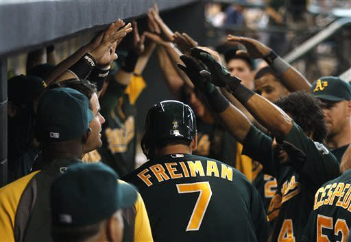 Colon leads A's to 11th straight win over Astros