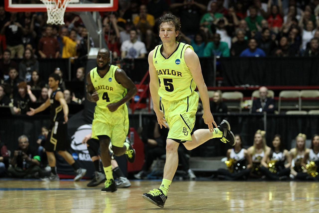 ALBUQUERQUE, NM - MARCH 17: Brady Heslip #5 of the Baylor Bears celebrates hitting a 3-point shot in the first half against the Colorado Buffaloes during the third round of the 2012 NCAA Men's Basketball Tournament at The Pit on March 17, 2012 in Albuquerque, New Mexico.  (Photo by Christian Petersen/Getty Images)