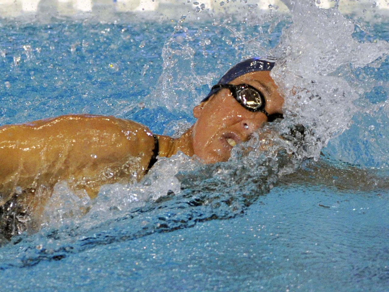 Janet Evans swims in the women's 800-meter freestyle preliminary race at the Austin Grand Prix swimming meet on Sunday, Jan. 15, 2012, in Austin, Texas. (AP Photo/Michael Thomas)