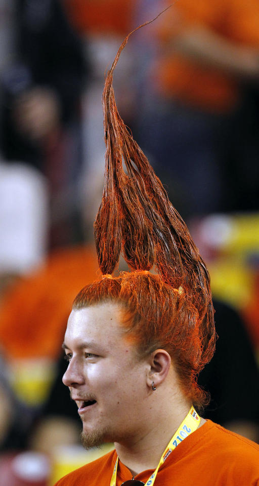 An Oklahoma State fan watches his team warm up prior to the Fiesta Bowl NCAA college football game against Stanford Monday, Jan. 2, 2012, in Glendale, Ariz.(AP Photo/Ross D. Franklin)