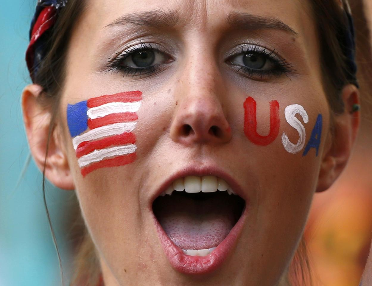 A U.S. fan cheers before the 2014 World Cup round of 16 game between Belgium and the U.S. at the Fonte Nova arena in Salvador July 1, 2014. REUTERS/Michael Dalder (BRAZIL - Tags: SOCCER SPORT WORLD CUP)