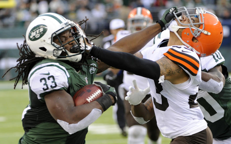 onNew York Jets running back Chris Ivory (33) stiff-arms Cleveland Browns' Joe Haden (23) during the second half of an NFL football game on Sunday, Dec. 22, 2013, in East Rutherford, N.J