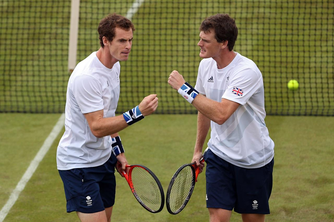 LONDON, ENGLAND - JULY 28:  Andy Murray and Jamie Murray of Great Britain play against Alexander Peya and Jurgen Melzer of Austria during their Men's Doubles Tennis match on Day 1 of the London 2012 Olympic Games at the All England Lawn Tennis and Croquet Club in Wimbledon on July 28, 2012 in London, England.  (Photo by Clive Brunskill/Getty Images)