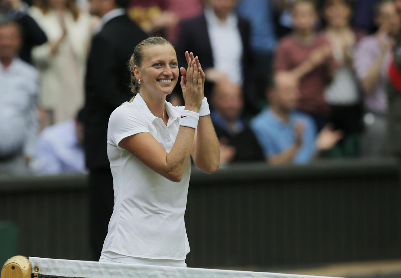 Petra Kvitova of Czech Republic celebrates after defeating Eugenie Bouchard of Canada in the women's singles final at the All England Lawn Tennis Championships in Wimbledon, London, Saturday, July 5, 2014. (AP Photo/Pavel Golovkin)