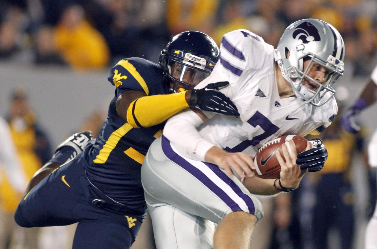 MORGANTOWN, WV - OCTOBER 20:  Collin Klein #7 of the Kansas State Wildcats carries the ball against the West Virginia Mountaineers of the West Virginia Mountaineers during the game on October 20, 2012 at Mountaineer Field in Morgantown, West Virginia.  (Photo by Justin K. Aller/Getty Images)