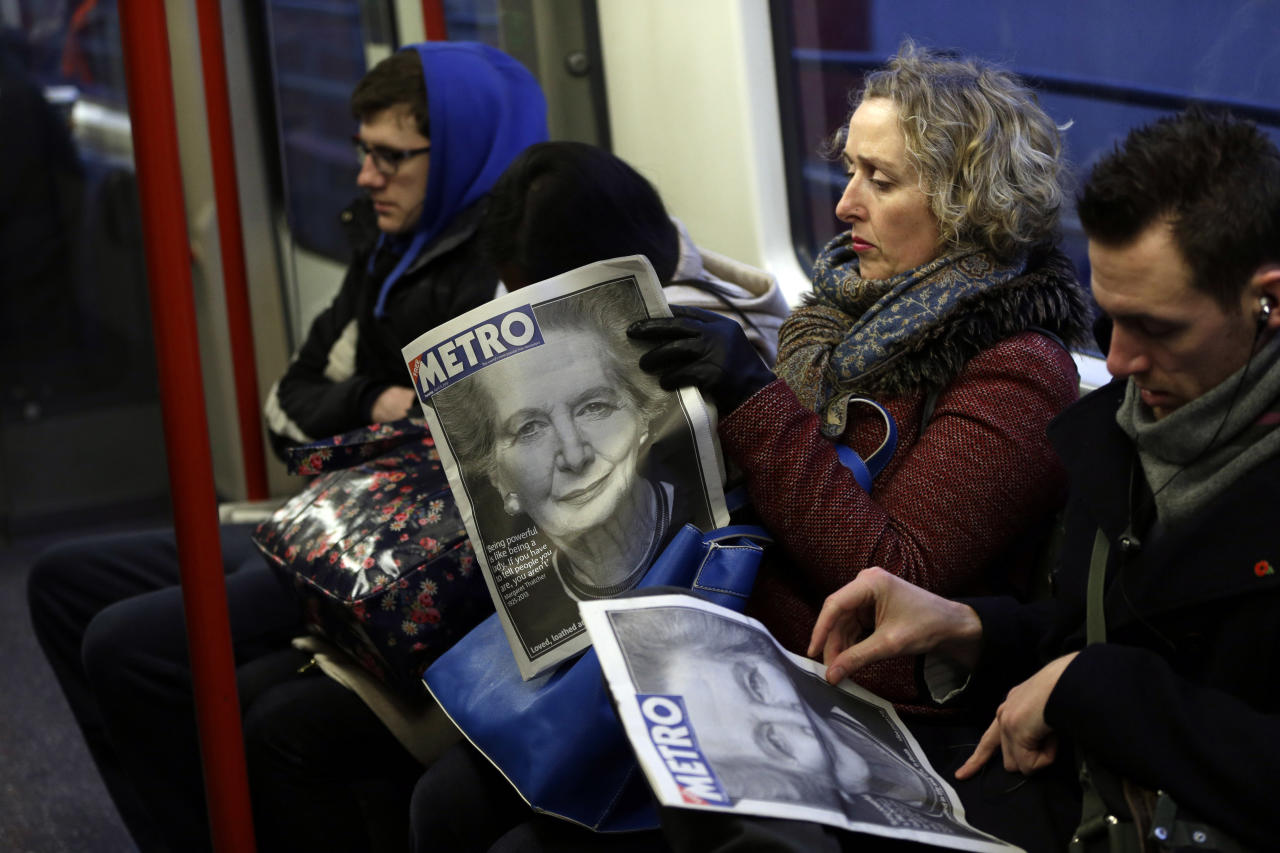 "Commuters read on a train daily newspapers featuring front-page coverage of former British Prime Minister Margaret Thatcher's death, in London, Tuesday, April 9, 2013. Margaret Thatcher, the combative ""Iron Lady"" who infuriated European allies, found a fellow believer in former US President Ronald Reagan and transformed her country by a ruthless dedication to free markets in 11 bruising years as prime minister, died Monday, April 8, 2013. She was 87 years old. (AP Photo/Lefteris Pitarakis)"