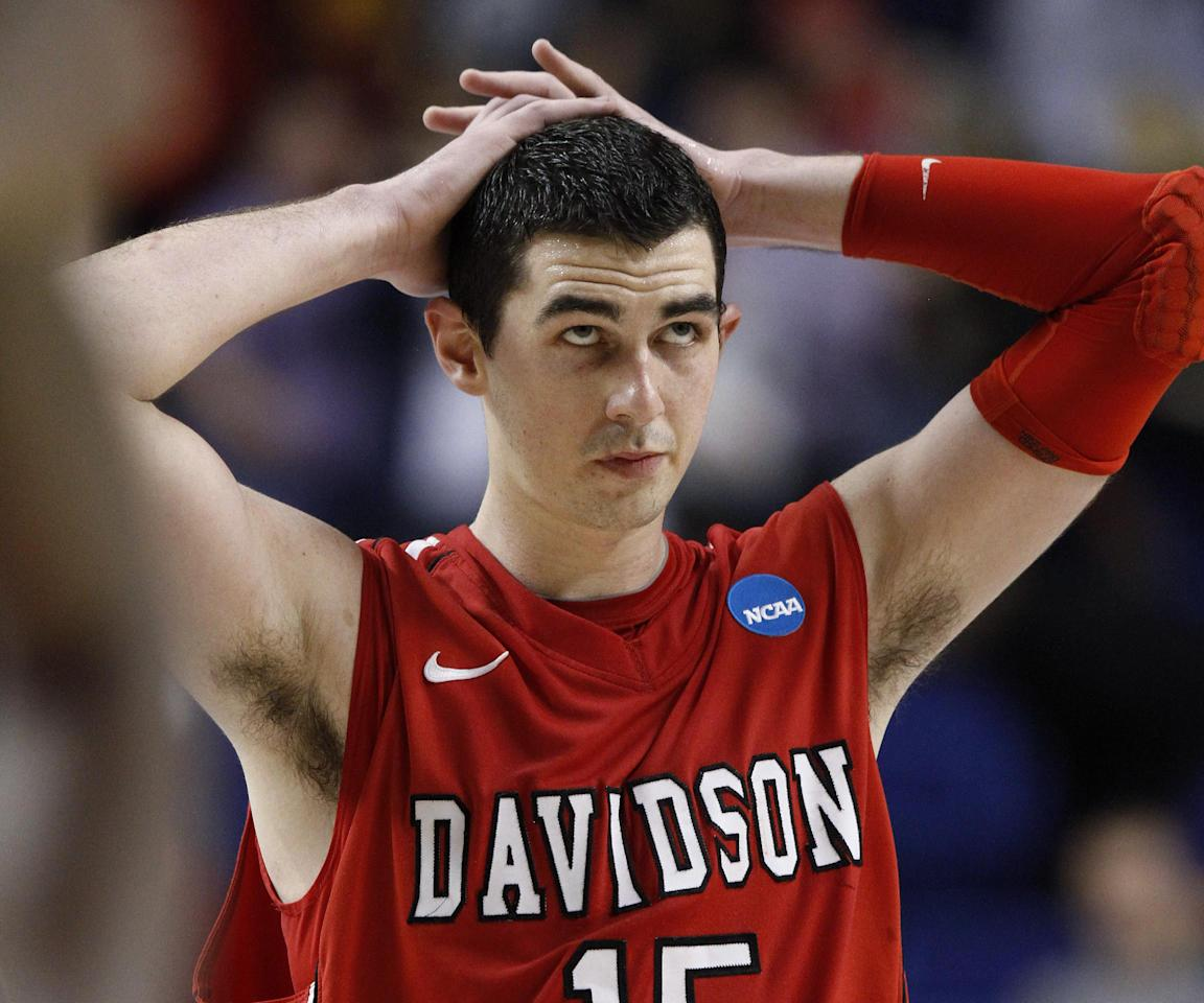 Davidson forward Jake Cohen walks off the court after Davidson's 59-58 loss to Marquette in a second-round NCAA college basketball tournament game Thursday, March 21, 2013, in Lexington, Ky. (AP Photo/James Crisp)