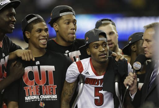 Louisville beats Michigan 82-76 for NCAA title