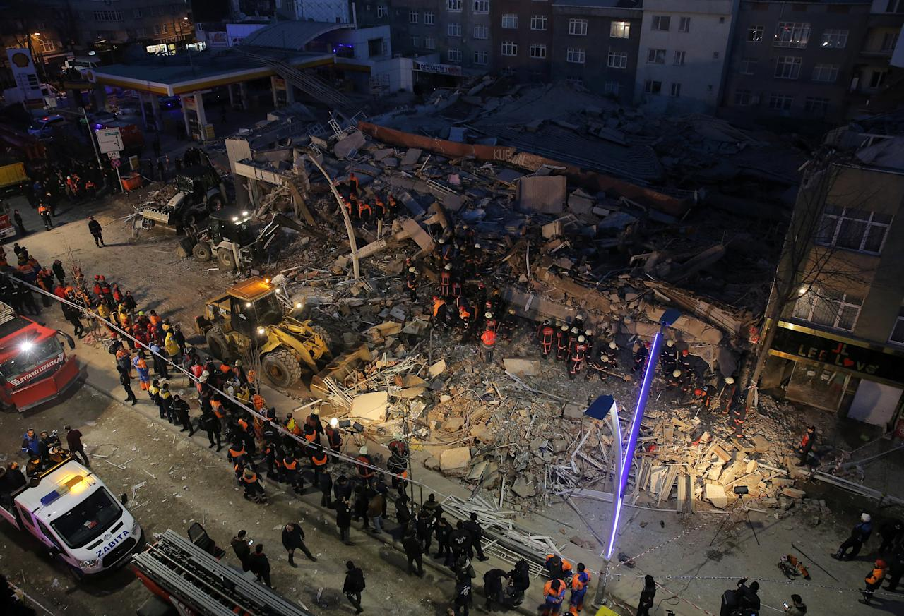 Firemen and rescue workers stand on the wreckage of a building that collapsed and caused several casualities, according to local media, in Istanbul, Turkey, January 13, 2017. REUTERS/Huseyin Aldemir     TPX IMAGES OF THE DAY