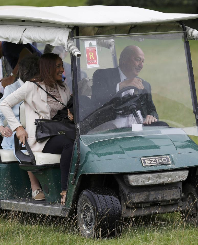 Olympic medallist Jessica Ennis-Hill (L) is driven in a golf buggy by the Duke of Devonshire during the country fair at Chatsworth House near Bakewell in Britain, September 2, 2016. REUTERS/Darren Staples