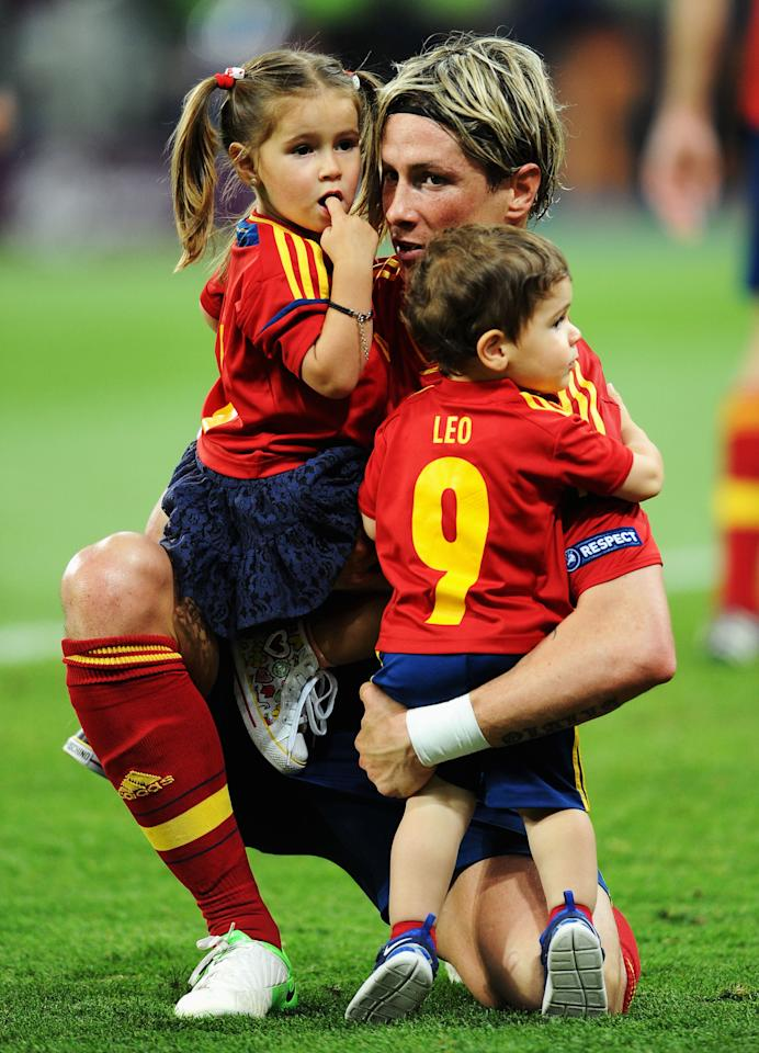 KIEV, UKRAINE - JULY 01:  Fernando Torres of Spain holds his children Nora Torres (L) and Leo Torres (R) after the UEFA EURO 2012 final match between Spain and Italy at the Olympic Stadium on July 1, 2012 in Kiev, Ukraine.  (Photo by Jasper Juinen/Getty Images)