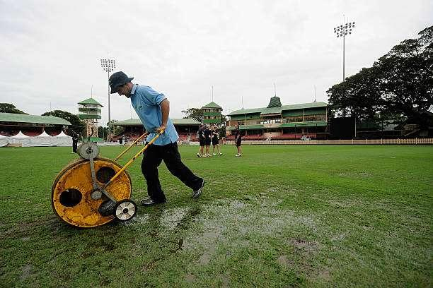 SYDNEY, AUSTRALIA - FEBRUARY 16: Grounds staff work to dry the pitch as rain delays the start of play during the WNCL Final match between NSW and Victoria on February 16, 2014 in Sydney, Australia. (Photo by Brett Hemmings/Getty Images)