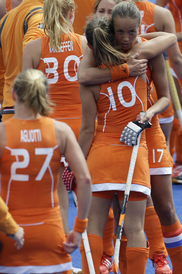 The Netherlands field hockey team congratulates each other shortly after defeating Belgium 3-0 in the women's hockey preliminary match at the 2012 Summer Olympics, Sunday, July 29, 2012, in London. (AP Photo/Bullit Marquez)
