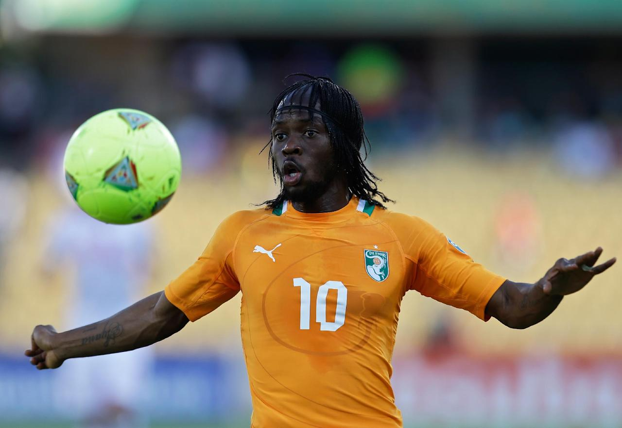 FILE - In this Jan. 26, 2013, file photo, Ivory Coast's Gervinho eyes the ball during their African Cup of Nations group D match with Tunisia at the Royal Bafokeng stadium in Rustenburg, South Africa. The two other teams in group D are Togo and Algeria. The Elephants had a comfortable qualification run under French coach Sabri Lamouchi, with a team filled with Europe-based talent including Manchester City's Yaya Toure. (AP Photo/Armando Franca, File)