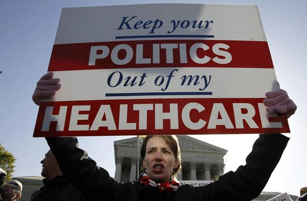Amy Brighton from Medina, Ohio, who opposes health care reform, rallies in front of the Supreme Court.