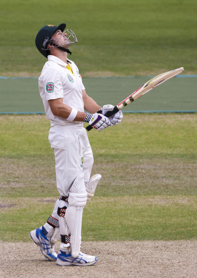 Australia's Ed Cowan reacts after being caught by the Nottinghamshire player James Taylor who is playing as a guest of Sussex during day one of the international tour match at the BrightonandHoveJobs.com County Cricket Ground, Hove.