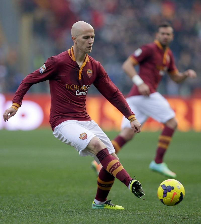 In this Dec. 22, 2013, photo, AS Roma's Michael Bradley controls the ball during a Serie A soccer match against Catania in Rome. Roma coach Rudi Garcia says American midfielder Bradley is on the verge of joining Toronto FC. Italian media report Roma has accepted an offer of 7 million euros ($9.5 million) for Bradley from the Major League Soccer club