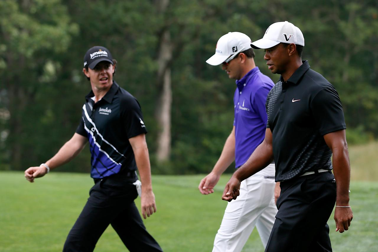 FARMINGDALE, NY - AUGUST 23:  (From right) Tiger Woods, Zach Johnson and Rory McIlroy of Northern Ireland walk down the 13th fairway during the First Round of The Barclays on the Black Course at Bethpage State Park August 23, 2012 in Farmingdale, New York.  (Photo by Kevin C. Cox/Getty Images)