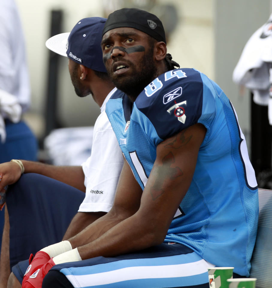 Tennessee Titans' Randy Moss sits on the bench during the NFL football game against the Miami Dolphins in Miami, Sunday, Nov. 14, 2010. The Dolphins won 29-17. Moss had just one catch during the game.