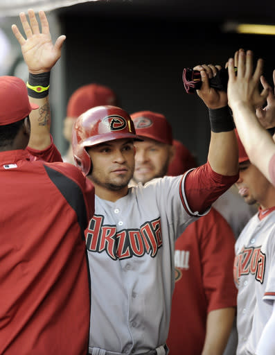 Owings leads D-backs to 12-7 win over Rockies