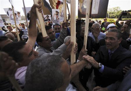Gamal al-Sadat (R), son of late President Anwar Sadat, shakes hands with people and supporters of the army at his father's tomb, during the 40th anniversary of Egypt's attack on Israeli forces in the 1973 war, at Cairo's Nasr City district, October 6, 2013. REUTERS/Amr Abdallah Dalsh