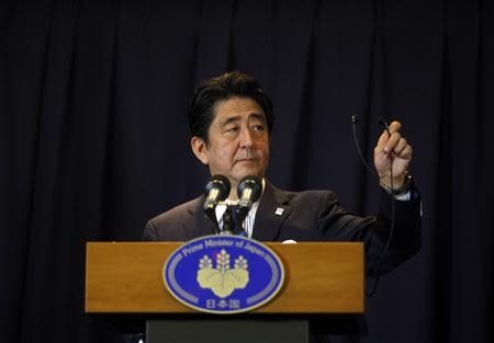 Japan's Prime Minister Shinzo Abe addresses a news conference after Tokyo was selected as the city to host the 2020 Summer Olympic Games in Buenos Aires