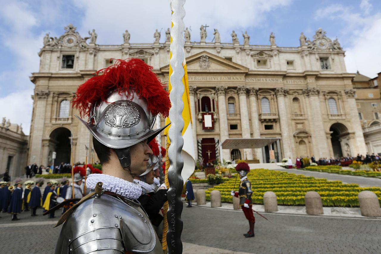 """Swiss guards stand in St. Peter's square at the Vatican on the occasion of the celebration of the Easter mass Sunday, March 31, 2013. """"Our daily problems and worries can wrap us up in ourselves, in sadness and bitterness, and that is where death is,"""" he said. """"Let the risen Jesus enter your life, welcome him as a friend, with trust: he is life!"""" said Pope Francis during the Easter vigil. (AP Photo/Andrew Medichini)"""