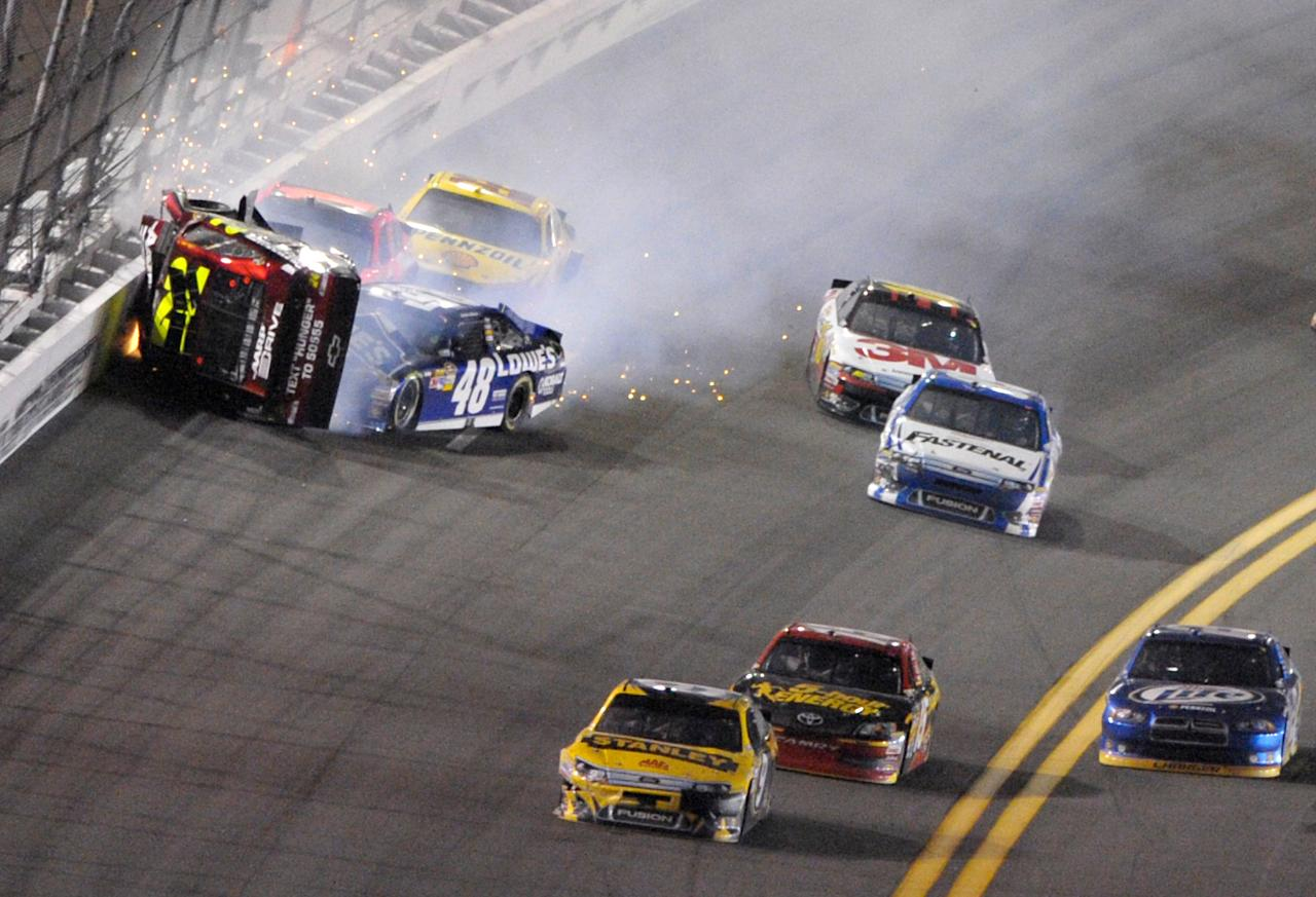 Jeff Gordon's car ends up on its side during a crash in the NASCAR Budweiser Shootout auto race at Daytona International Speedway, Saturday, Feb. 18, 2012, in Daytona Beach, Fla. Jimmie Johnson (48) is among the drivers involved in the wreck. (AP Photo/Phelan M. Ebenhack)