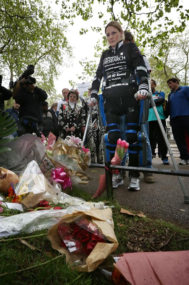 LONDON, ENGLAND - MAY 08:  Claire Lomas stands at a floral tribute to Claire Squires who died running the Virgin London Marathon on May 8, 2012 in London, England. Ms Lomas, who is paralysed from the waist down after a riding accident in 2007, has taken 16 days to complete the 26.2 mile route. Starting out with 36,000 other runners she has averaged 2 miles a day with the help of a bionic ReWalk suit.  (Photo by Peter Macdiarmid/Getty Images)