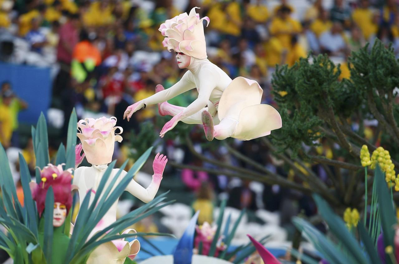 Performers participate in the opening ceremony of the 2014 World Cup at the Corinthians arena in Sao Paulo June 12, 2014. REUTERS/Damir Sagolj (BRAZIL - Tags: SPORT SOCCER WORLD CUP SOCIETY)