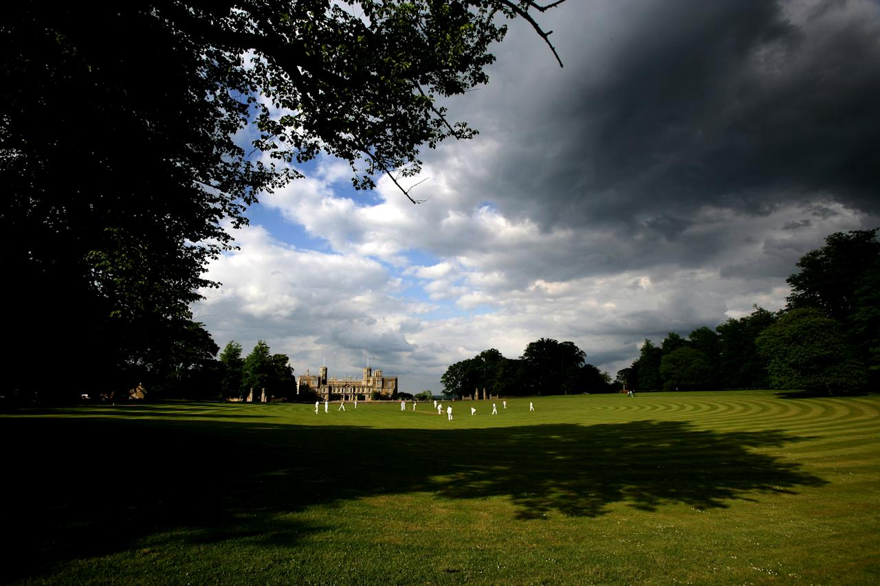 CASTLE ASHBY, ENGLAND - MAY 20: A general view of a Village Cricket game being played at Castle Ashby House Cricket Club on May 20, 2007 in Castle Ashby, England. (Photo by Laurence Griffiths/Getty Images)