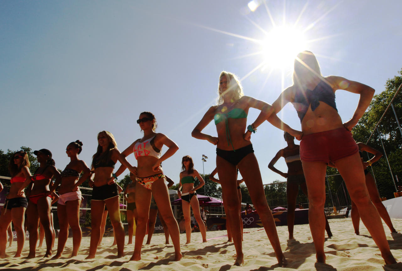 Dancers rehearse their performances for the London 2012 Olympic Beach Volleyball matches at the practice facility near to Horse Guards Parade in London July 24, 2012. REUTERS/Luke MacGregor (BRITAIN - Tags: SPORT OLYMPICS VOLLEYBALL)