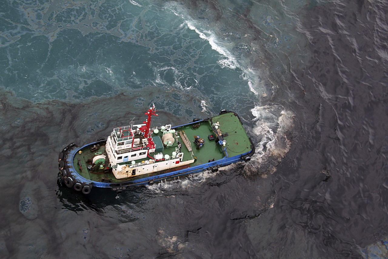 In this photo taken Saturday, July 27, 2013, a cleaning vessel clears the oil after about 50 tons of crude oil was leak from a pipe spilled into the sea off Rayong province, eastern Thailand. The oil spill that leaked from a pipeline, operated by a subsidiary of state-owned oil and gas company PTT Plc, has reached a popular tourist island in Thailand's eastern sea despite continuous attempts to clean it up over the weekend, officials said Monday. (AP Photo/The Nation-Atchara) THAILAND OUT