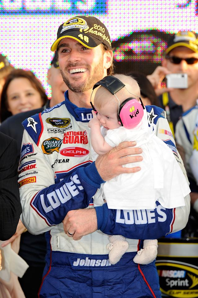 Jimmie Johnson, driver of the #48 Lowe's Chevrolet, celebrates with his daughter Genevieve after finishing in second place in the Ford 400 to clinch his fifth consecutive NASCAR Sprint Cup championship at Homestead-Miami Speedway on November 21, 2010 in Homestead, Florida.  (Photo by John Harrelson/Getty Images for NASCAR)