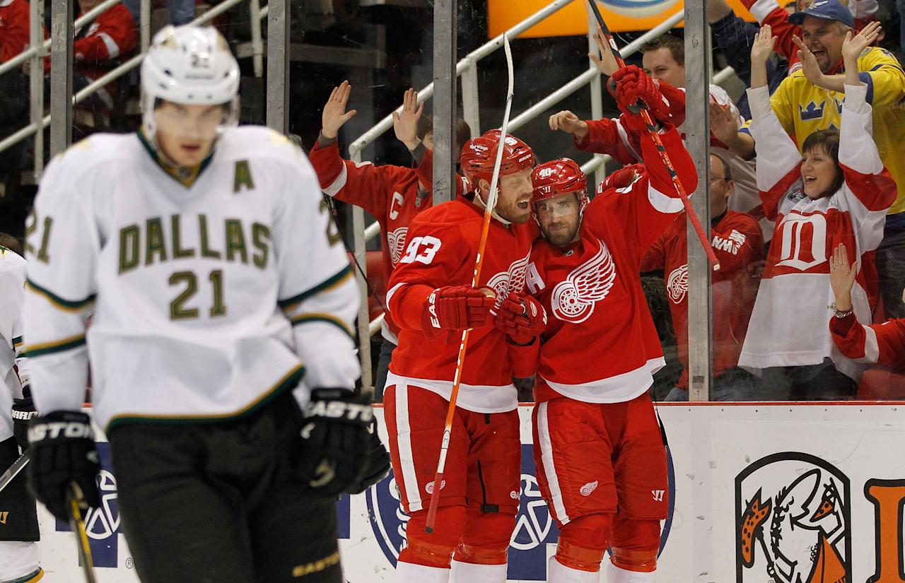 DETROIT, MI - FEBRUARY 14:  Henrik Zetterberg #40 of the Detroit Red Wings celebrates his first period goal with Johan Franzen #93 next to Loui Eriksson #21 of the Dallas Stars at Joe Louis Arena on February 14, 2012 in Detroit, Michigan. (Photo by Gregory Shamus/Getty Images)