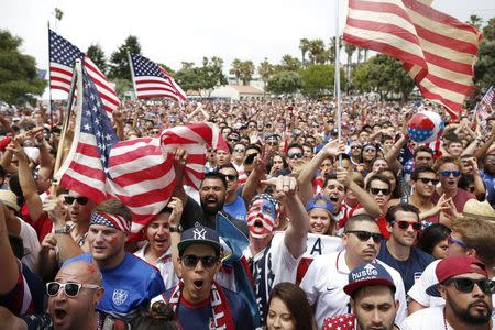 USA fans watch the 2014 World Cup round of 16 soccer match between Belgium and the U.S., at a viewing party in Redondo Beach
