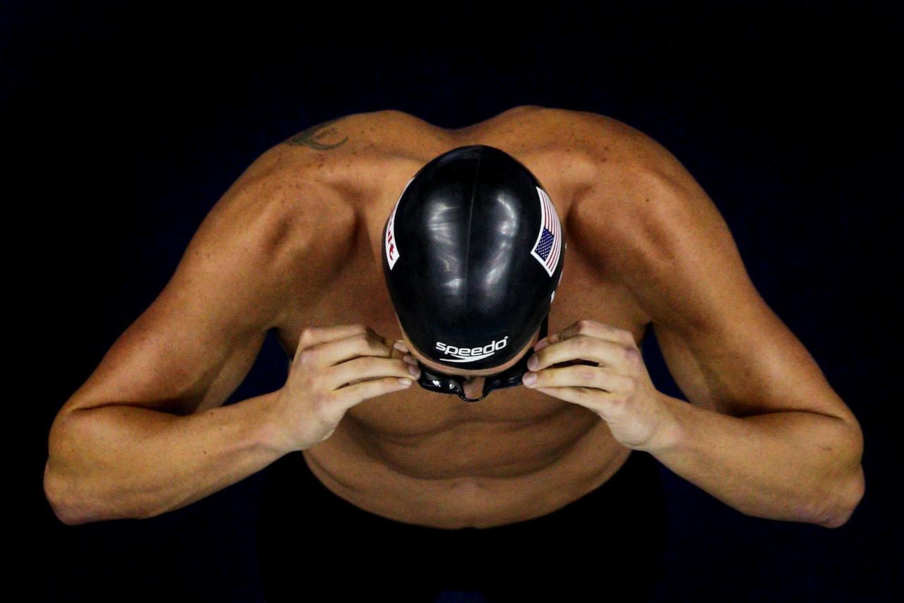 SHANGHAI, CHINA - JULY 29:  Ryan Lochte of the United States adjusts his goggles before the Men's 200m Backstroke Final during Day Fourteen of the 14th FINA World Championships at the Oriental Sports Center on July 29, 2011 in Shanghai, China.  (Photo by Feng Li/Getty Images)